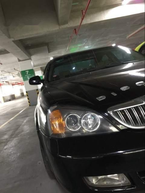Cần bán gấp Daewoo Magnus 2005, màu đen, xe nhập xe gia đình, giá tốt-0