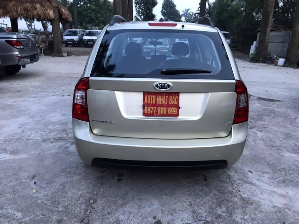 Bán xe Kia Carens 2.0AT 2.0AT, 7 chỗ, sản xuất 2009 màu vàng sâm banh, xe chạy ít, chính chủ biển HN-3