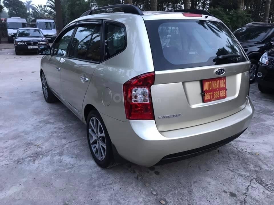 Bán xe Kia Carens 2.0AT 2.0AT, 7 chỗ, sản xuất 2009 màu vàng sâm banh, xe chạy ít, chính chủ biển HN-4