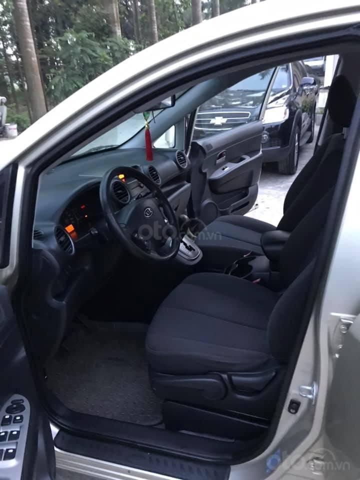 Bán xe Kia Carens 2.0AT 2.0AT, 7 chỗ, sản xuất 2009 màu vàng sâm banh, xe chạy ít, chính chủ biển HN-13