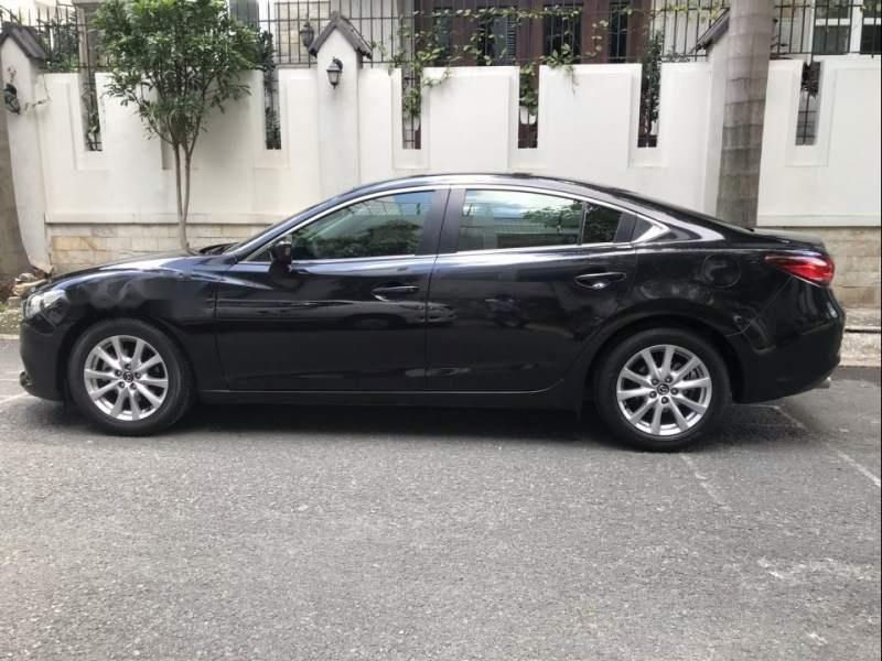Cần bán Mazda 6 năm 2015, màu đen, đi đúng đồng hồ 35000 km (1)