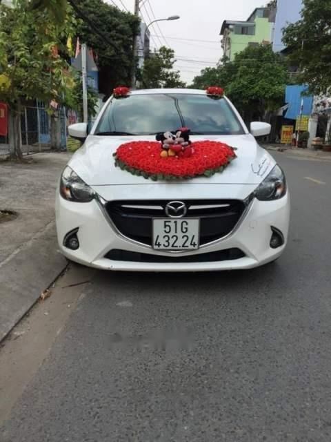 Cần bán Mazda 2 AT sản xuất 2017, màu trắng, xe nhà mình mua mới 7/2017 (2)