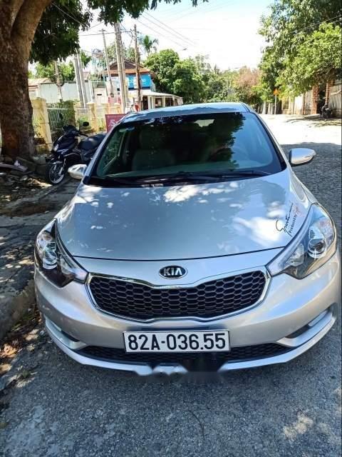 Cần bán gấp Kia K3 sản xuất 2016, màu bạc, xe gia đình còn mới leng keng-1