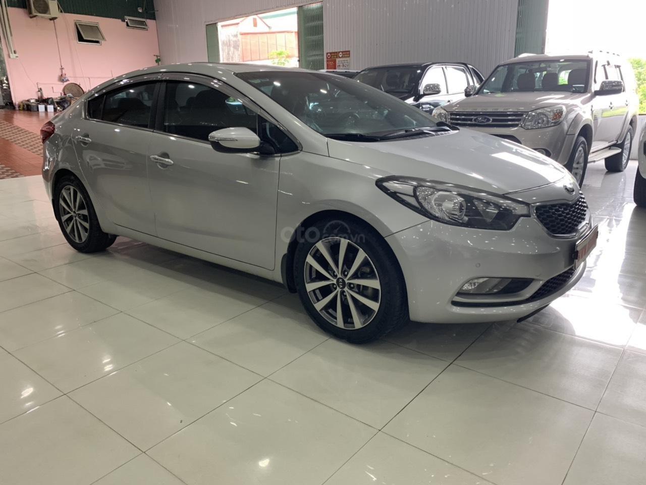Cần bán Kia K3 đời 2015, màu bạc (2)