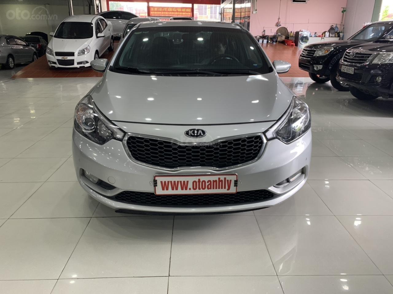 Cần bán Kia K3 đời 2015, màu bạc (1)