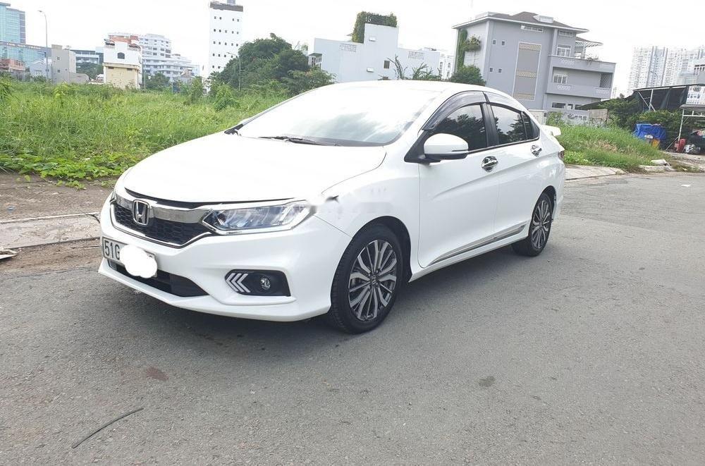 Cần bán Honda City 2018, màu trắng, xe còn mới-0