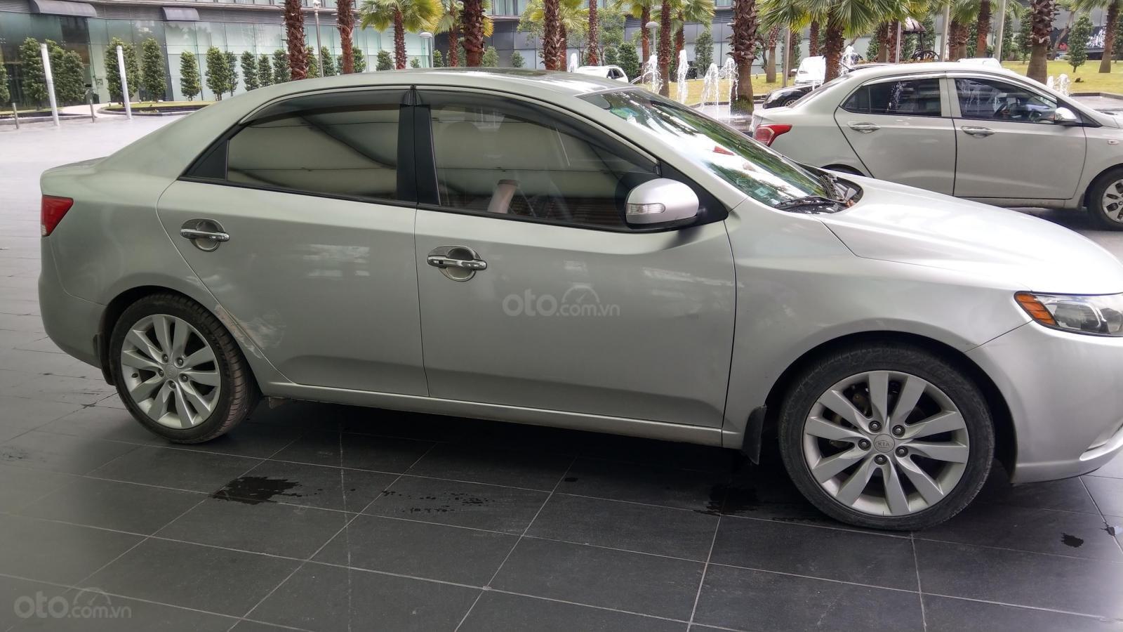 Cần bán xe Kia Forte SLI 1.6 AT năm 2009, màu bạc, nhập khẩu như mới  (1)