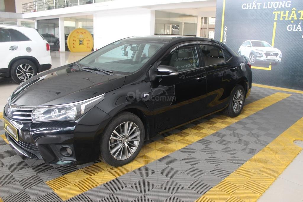 Cần bán xe Toyota Corolla Altis G 1.8 AT sản xuất năm 2015, màu đen (1)