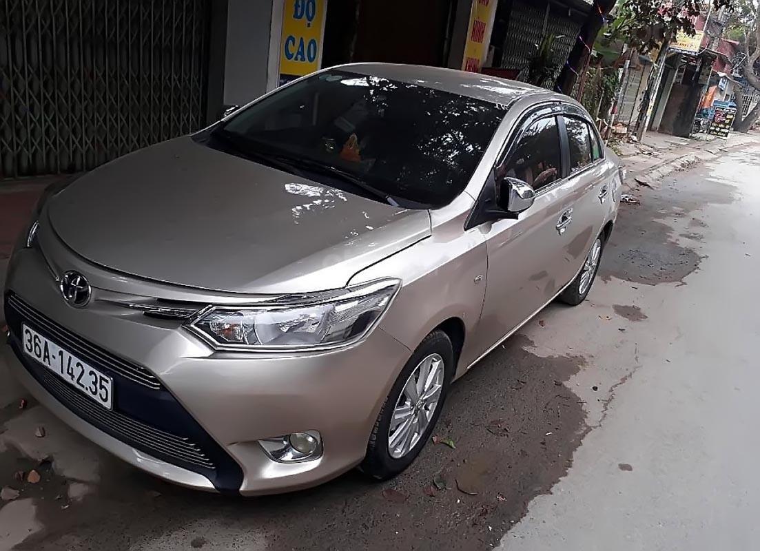 Cần tiền bán Toyota Vios 1.3J đời 2015, màu vàng cát (1)
