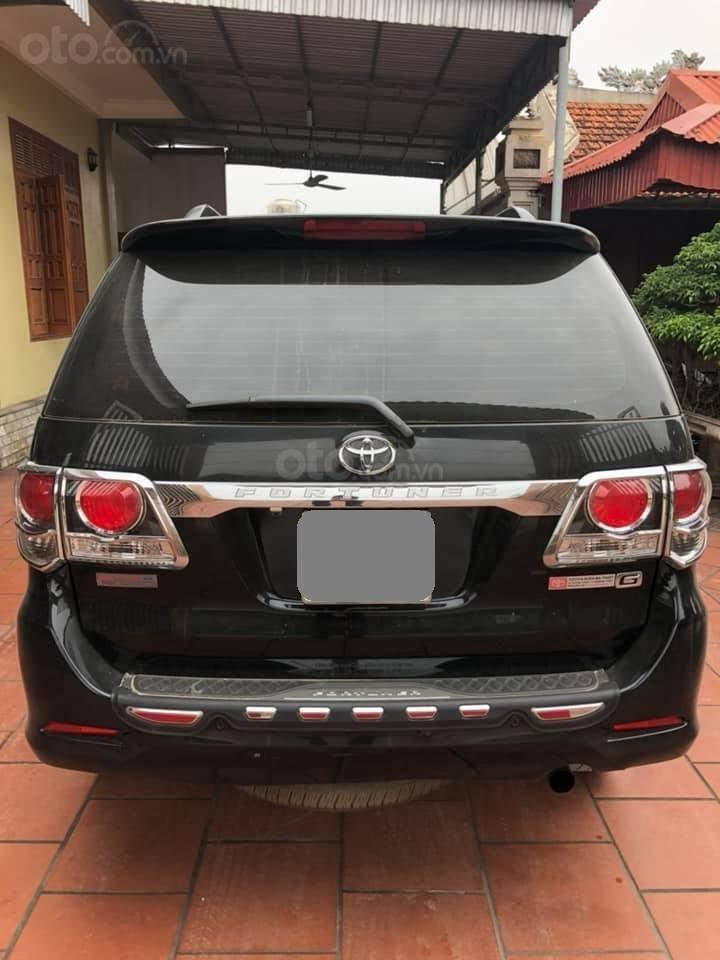 Bán Toyota Fortuner 2016 màu đen (3)
