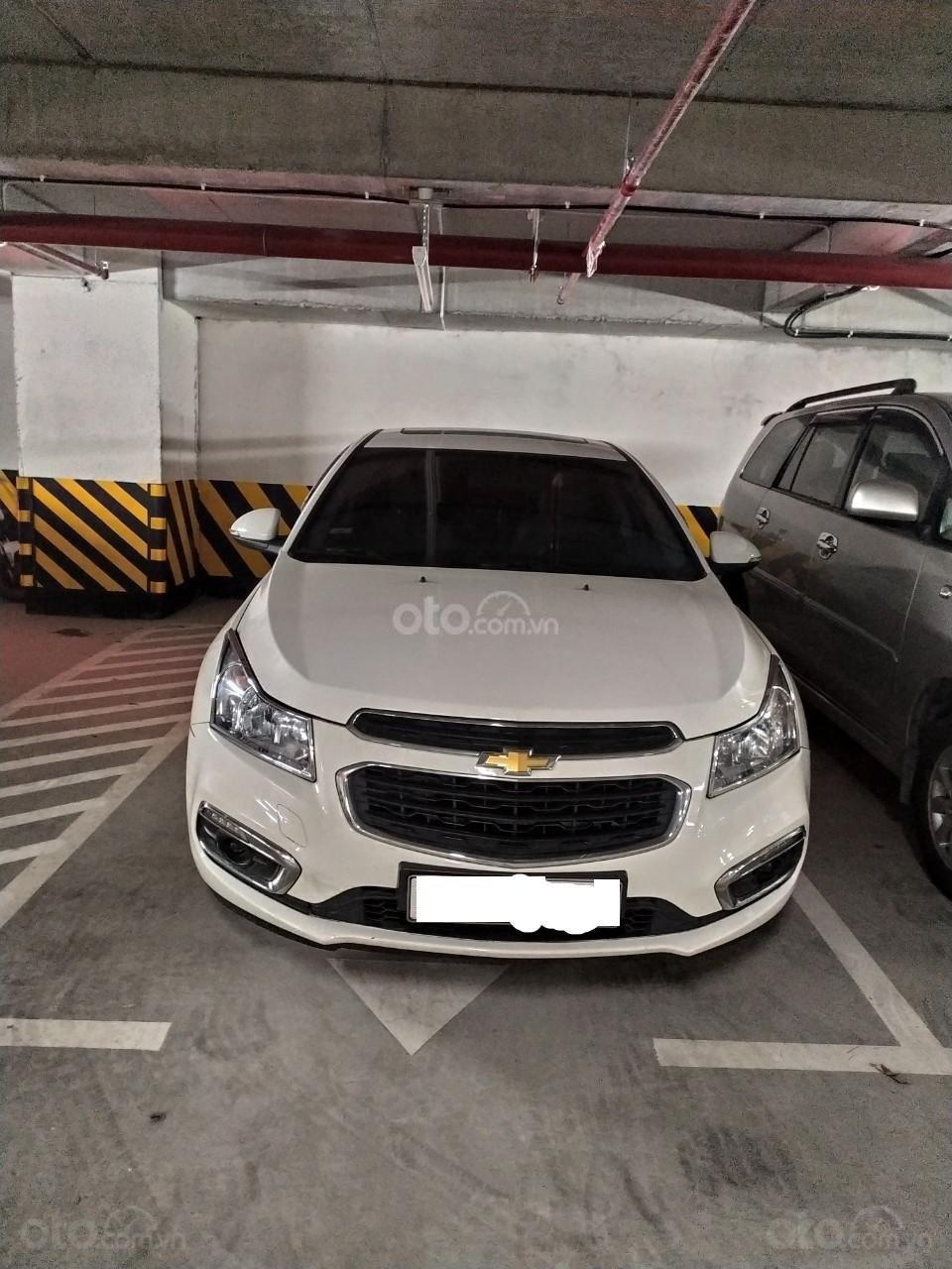 Bán xe Chevrolet Cruze 1.8, trắng, chính chủ, có lộc (1)