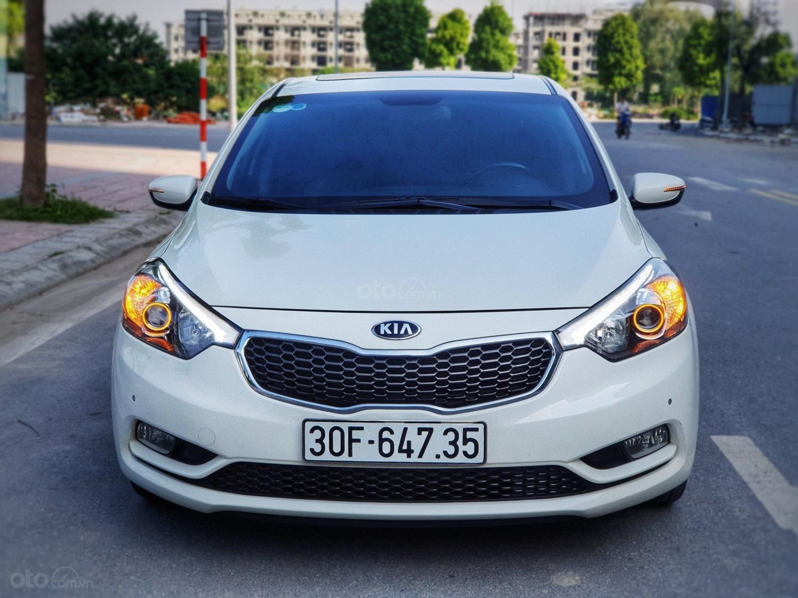 Cần bán lại xe Kia K3 2.0 2014, màu trắng, chất lượng đã được kiểm định (1)