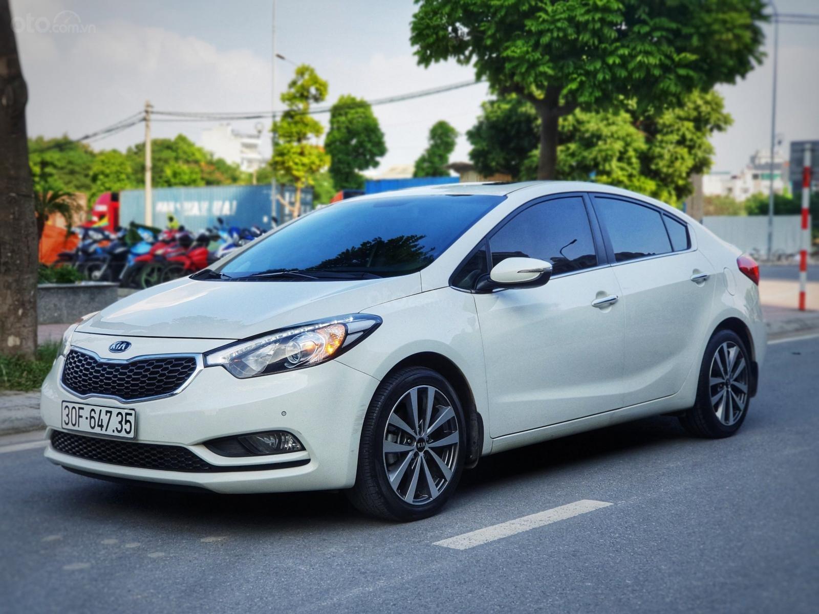 Cần bán lại xe Kia K3 2.0 2014, màu trắng, chất lượng đã được kiểm định (2)