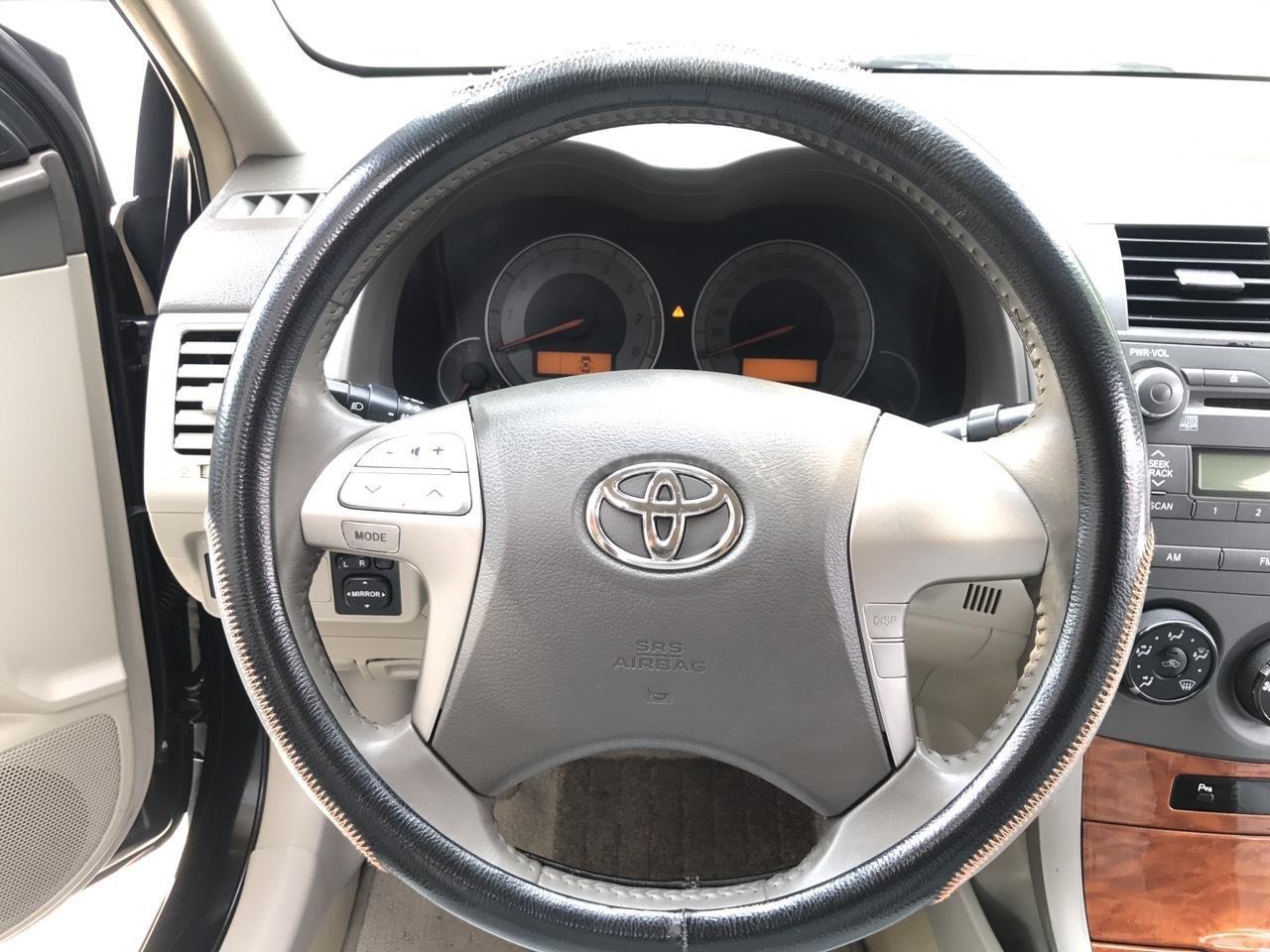 Cần bán Toyota Corolla Altis 1.8G đời 2010, màu đen, chính chủ cán bộ Sóc Sơn (6)