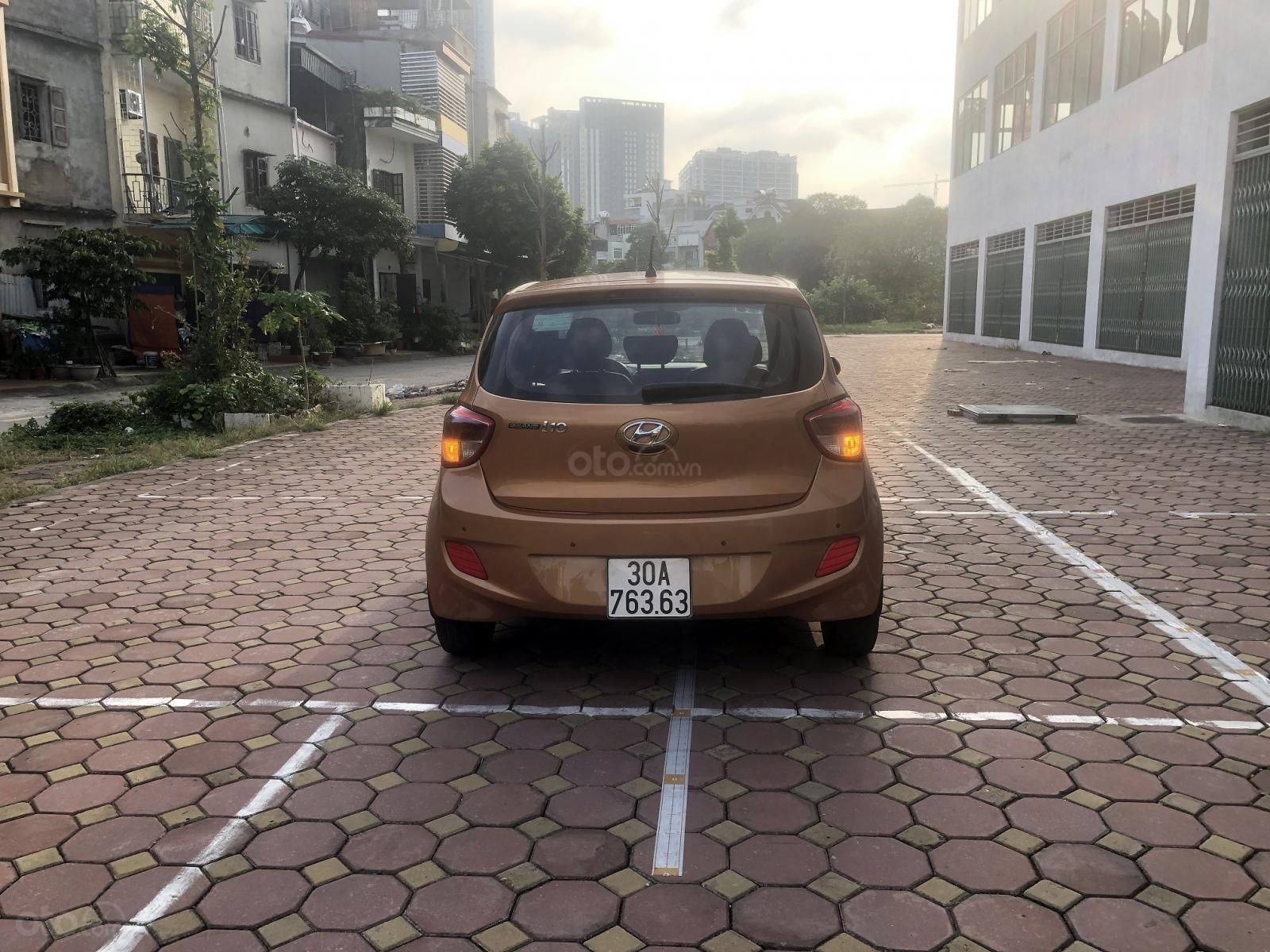 Bán xe Hyundai Grand i10 1.0 AT năm sản xuất 2015, màu cam, xe nhập Ấn Độ (4)