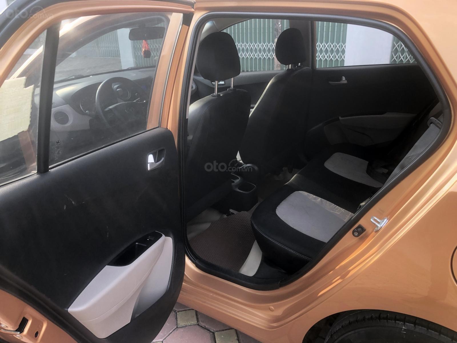Bán xe Hyundai Grand i10 1.0 AT năm sản xuất 2015, màu cam, xe nhập Ấn Độ (7)