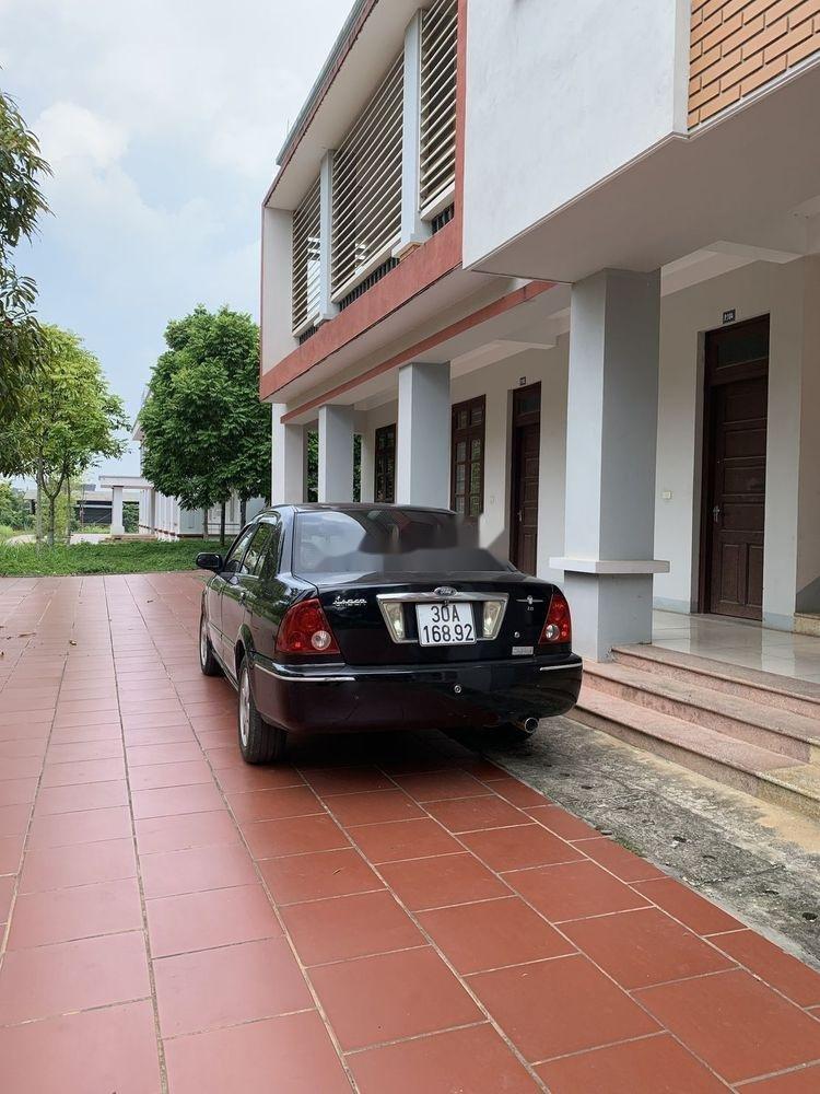 Bán Ford Laser đời 2003, màu đen, nhập khẩu, giá tốt (1)