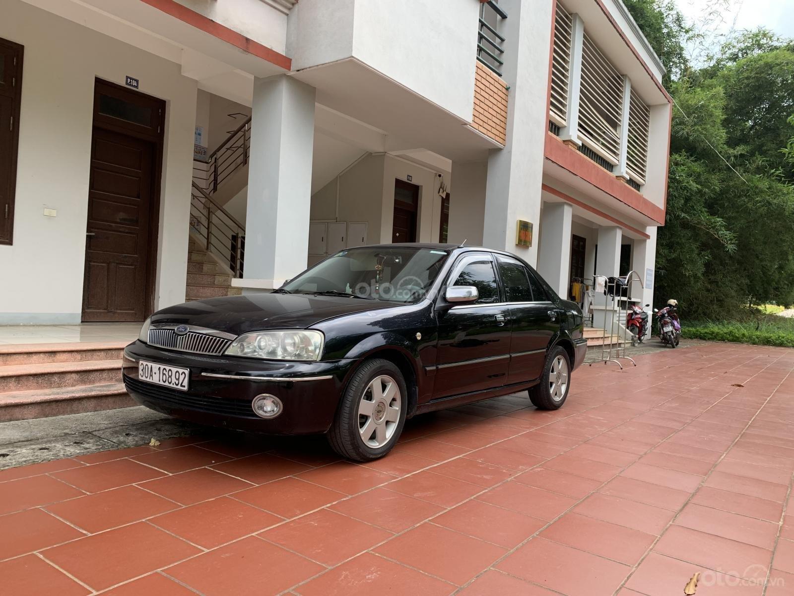 Bán Ford Laser 2003 đen, nhập, chính chủ, miễn trung gian (1)