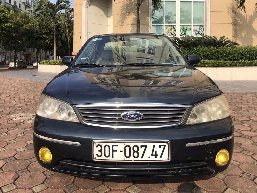 Bán Ford Laser năm 2004, màu đen chính chủ, 148tr (1)