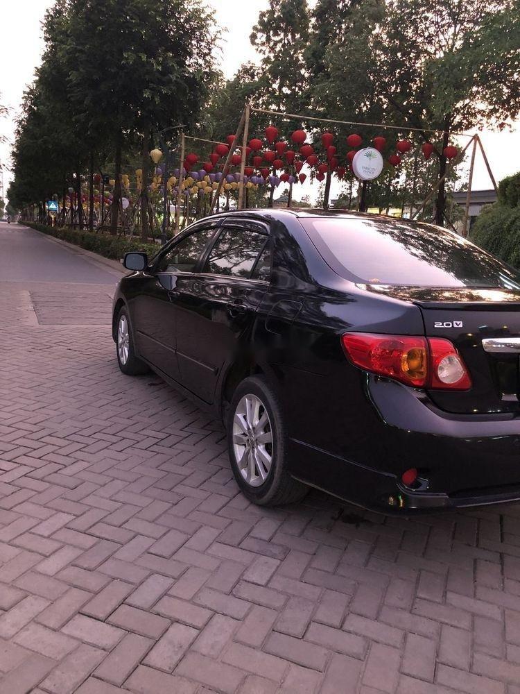 Cần bán gấp Toyota Corolla Altis 2.0AT đời 2010, màu đen còn mới, giá tốt (5)