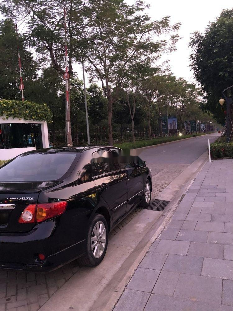 Cần bán gấp Toyota Corolla Altis 2.0AT đời 2010, màu đen còn mới, giá tốt (6)