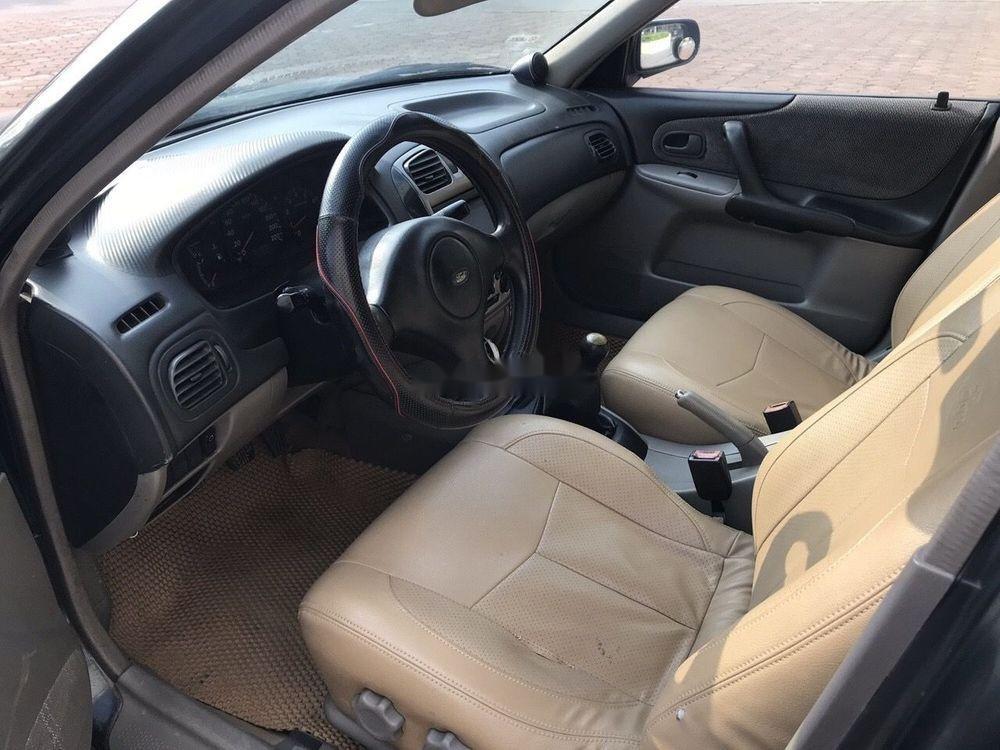 Bán Ford Laser năm 2004, màu đen chính chủ, 148tr (5)