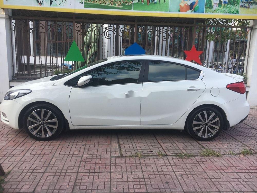 Bán Kia K3 1.6AT 2015 màu trắng, số tự động, giá tốt (1)