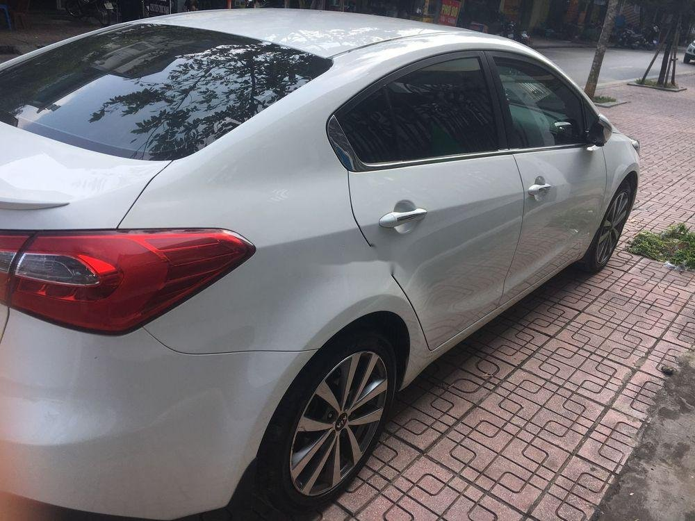 Bán Kia K3 1.6AT 2015 màu trắng, số tự động, giá tốt (3)
