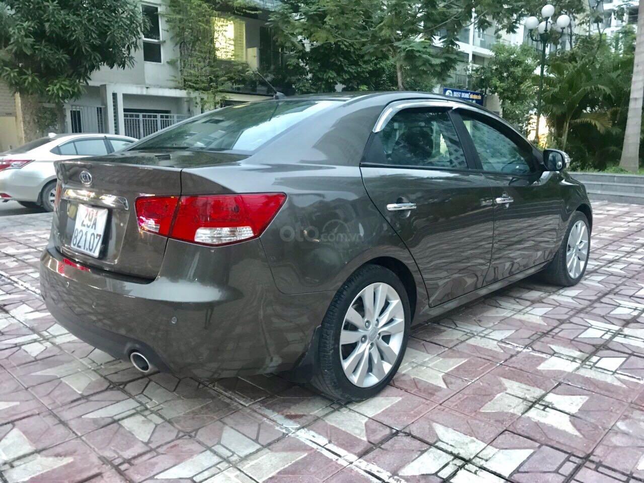 Bán ô tô Kia Cerato sản xuất 2010, màu nâu, xe gia đình giá tốt 370 triệu đồng (4)