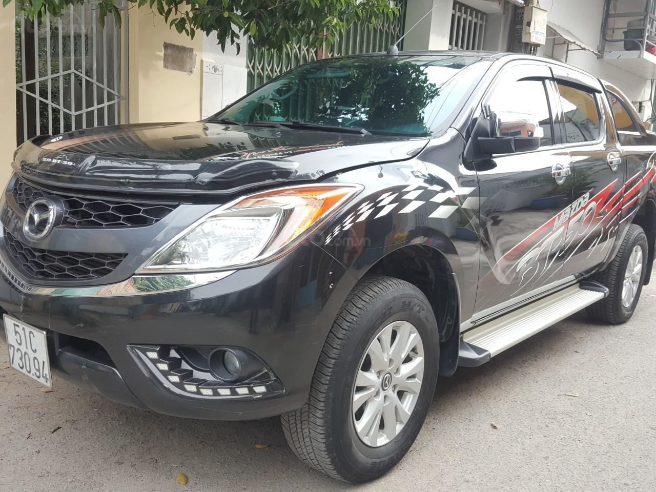 Bán tải Mazda BT50 2.2AT máy dầu, số tự động 1 cầu, màu đen, nhập Thái 2015, biển Sài Gòn (3)