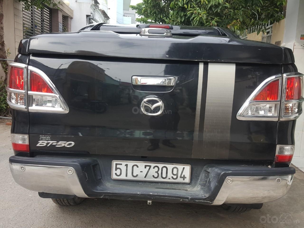 Bán tải Mazda BT50 2.2AT máy dầu, số tự động 1 cầu, màu đen, nhập Thái 2015, biển Sài Gòn (6)