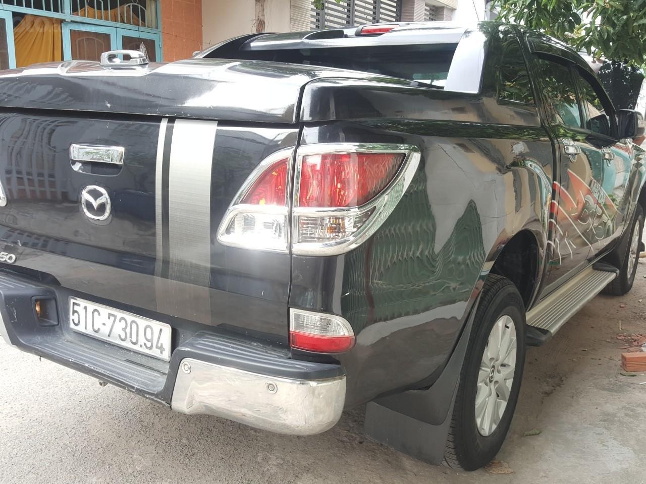 Bán tải Mazda BT50 2.2AT máy dầu, số tự động 1 cầu, màu đen, nhập Thái 2015, biển Sài Gòn (5)