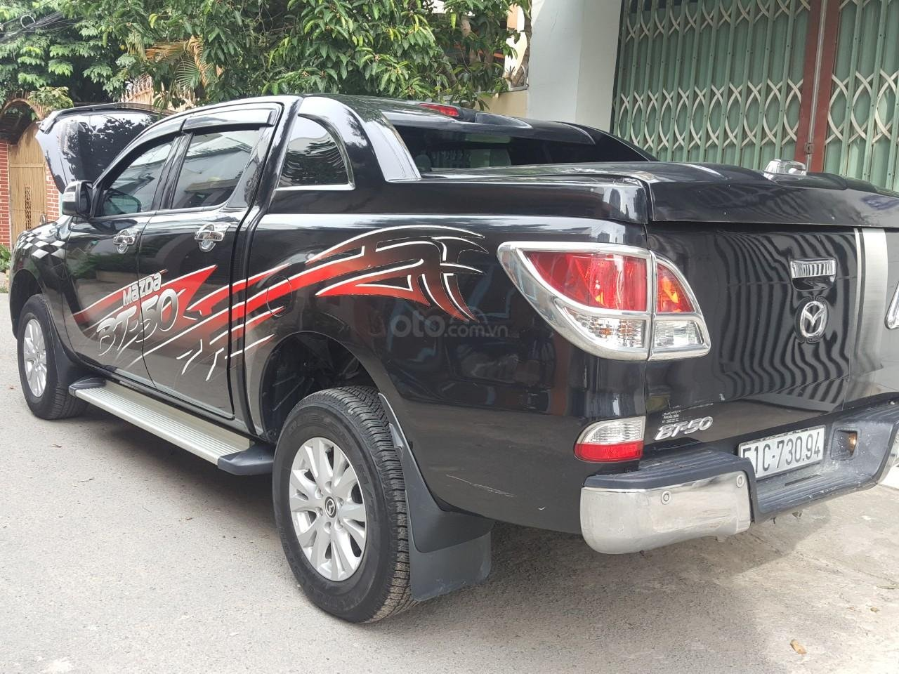 Bán tải Mazda BT50 2.2AT máy dầu, số tự động 1 cầu, màu đen, nhập Thái 2015, biển Sài Gòn (9)