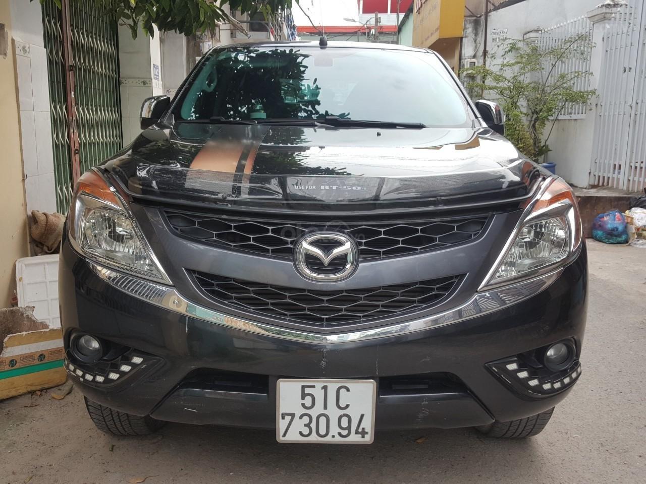 Bán tải Mazda BT50 2.2AT máy dầu, số tự động 1 cầu, màu đen, nhập Thái 2015, biển Sài Gòn (1)