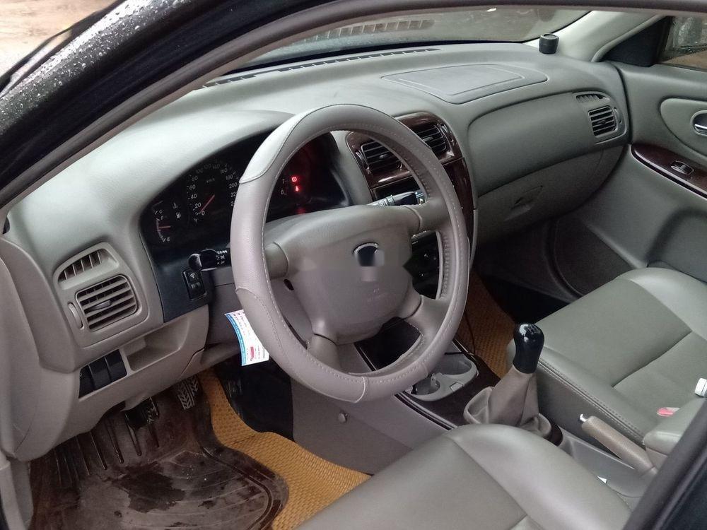 Cần bán lại xe Mazda 626 sản xuất 2003, màu đen chính chủ, giá tốt (2)