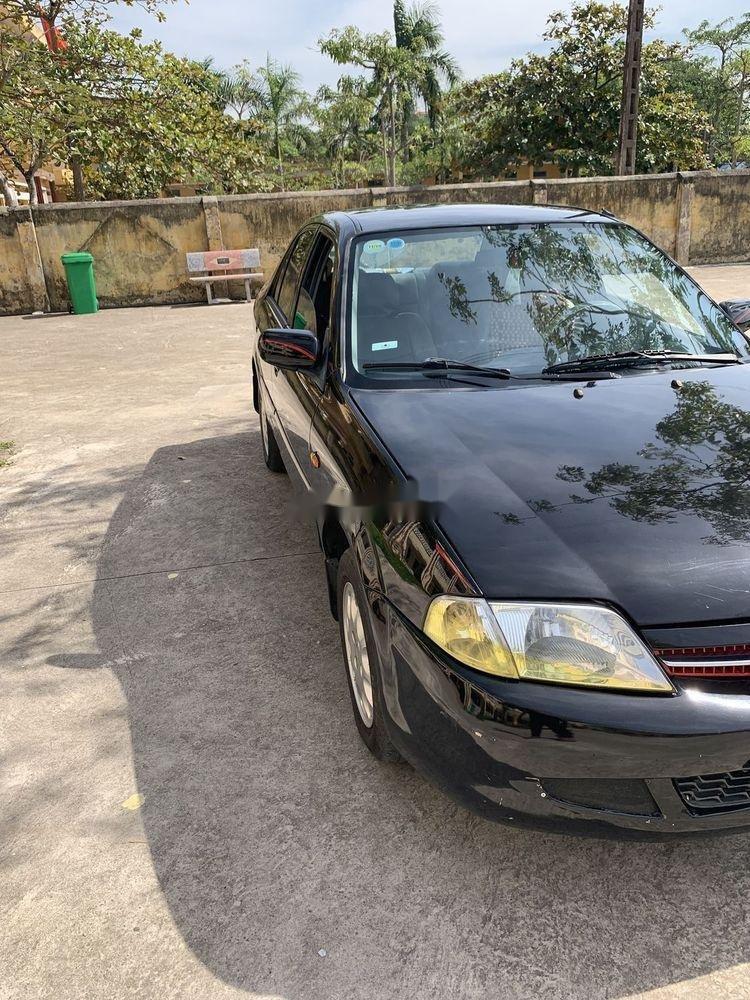 Bán xe Ford Laser 2000, màu đen chính chủ, giá rẻ (4)