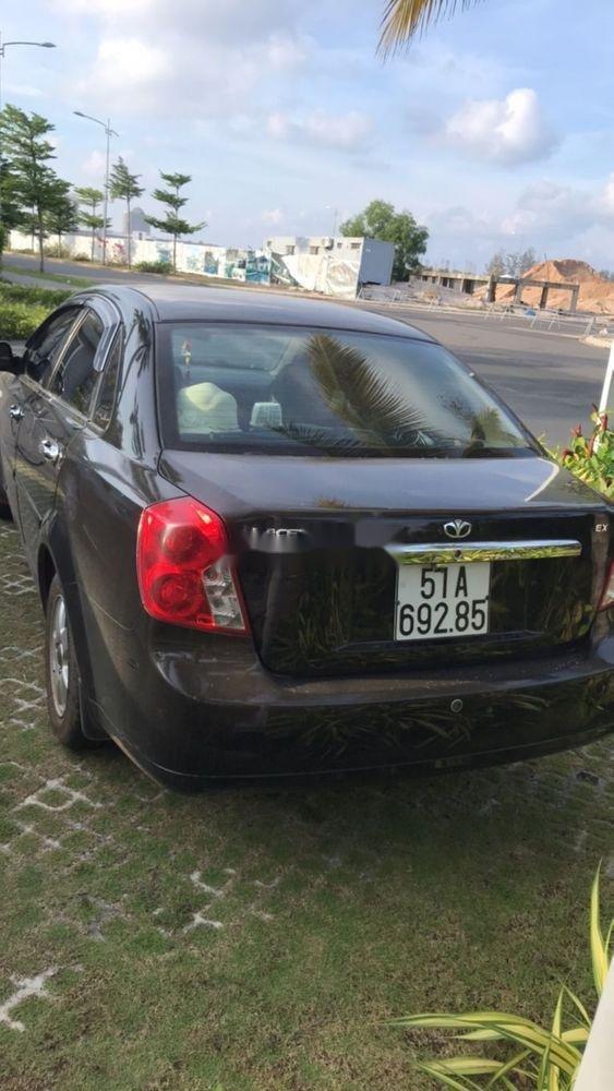 Cần bán xe cũ Daewoo Lacetti 2009, màu đen, nhập khẩu, 200tr (2)