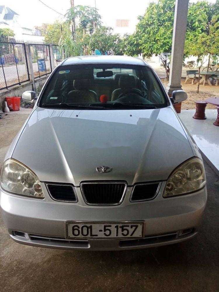 Cần bán Daewoo Lacetti sản xuất 2004, màu bạc, giá chỉ 142 triệu (2)