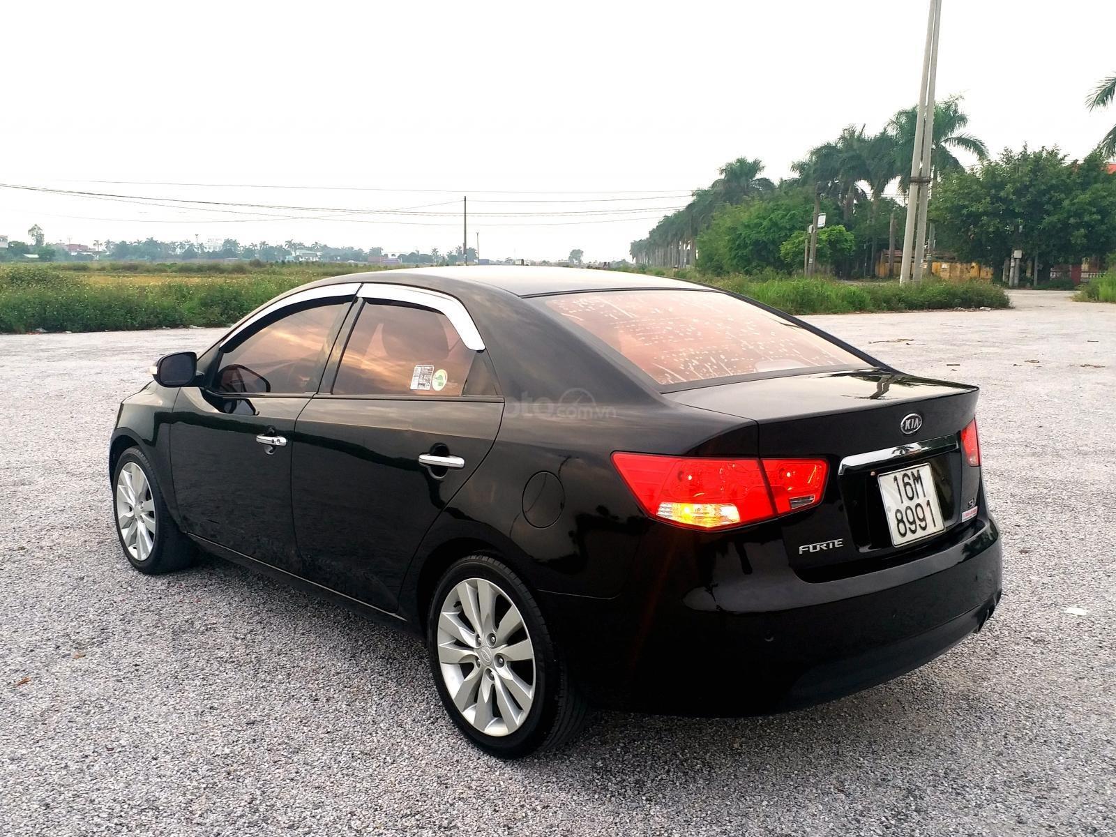 Cần bán Kia Forte sản xuất 2009, màu đen mới 95% giá tốt 320 triệu đồng (6)