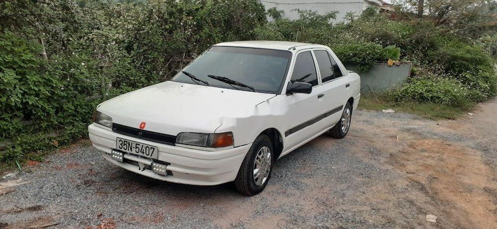 Bán Mazda 323 năm 1995, màu trắng xe gia đình, còn nguyên bản (1)