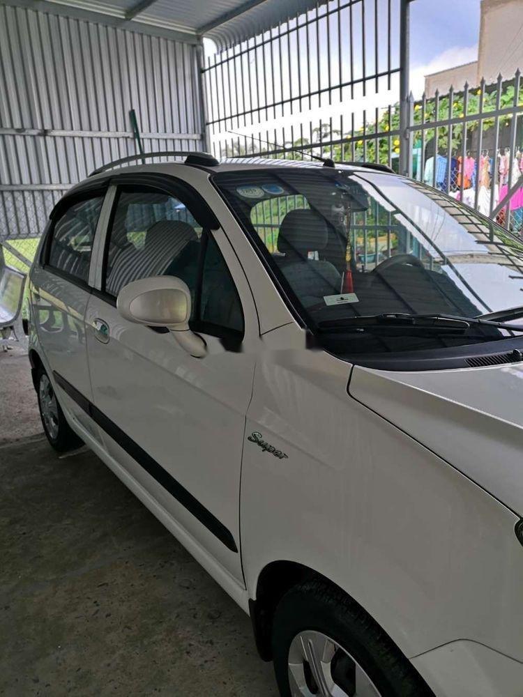 Cần bán Chevrolet Spark 2009, màu trắng, nhập khẩu, xe gia đình (1)
