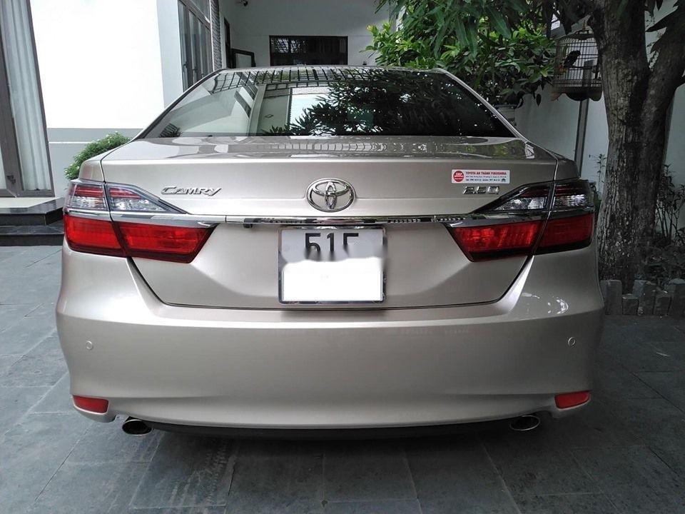 Bán Toyota Camry đời 2015, màu vàng, biển số SG (6)