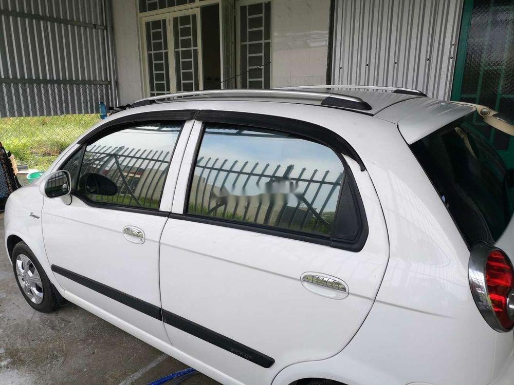 Cần bán Chevrolet Spark 2009, màu trắng, nhập khẩu, xe gia đình (2)