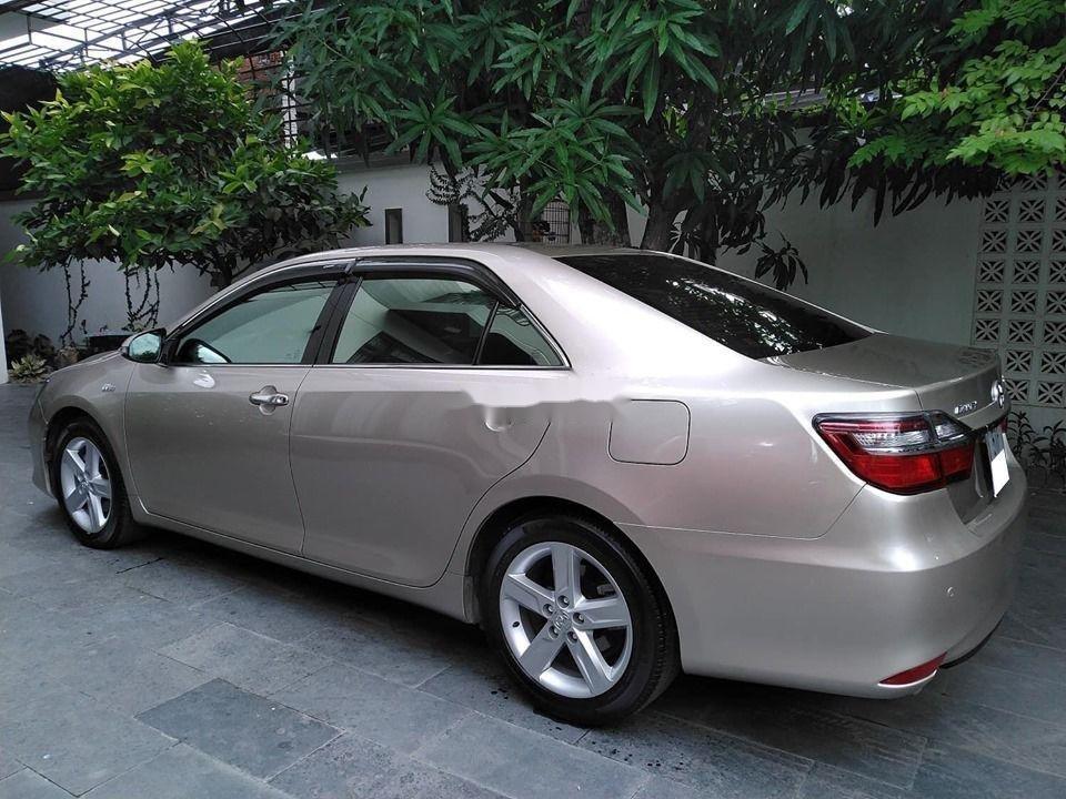 Bán Toyota Camry đời 2015, màu vàng, biển số SG (5)
