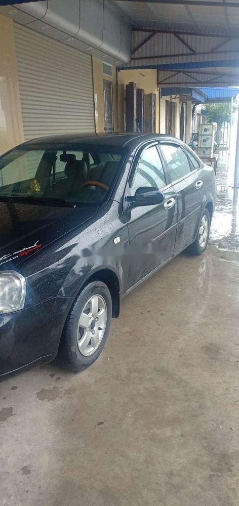 Cần bán xe Daewoo Lacetti sản xuất 2009, màu đen xe nguyên bản (1)