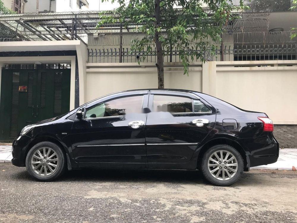 Cần bán Toyota Vios E MT năm 2013, màu đen xe gia đình (2)
