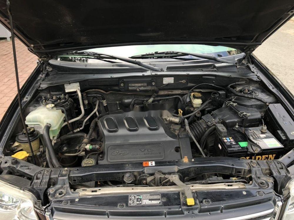 Cần bán gấp Ford Escape đời 2004, màu đen, giá tốt (8)