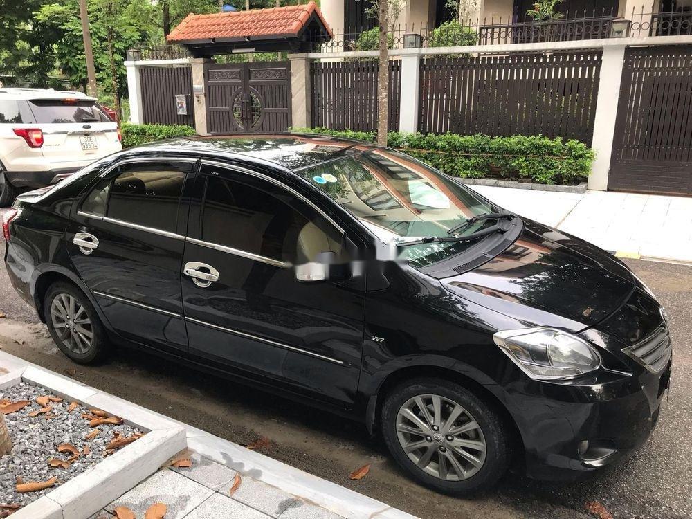 Cần bán Toyota Vios E MT năm 2013, màu đen xe gia đình (1)