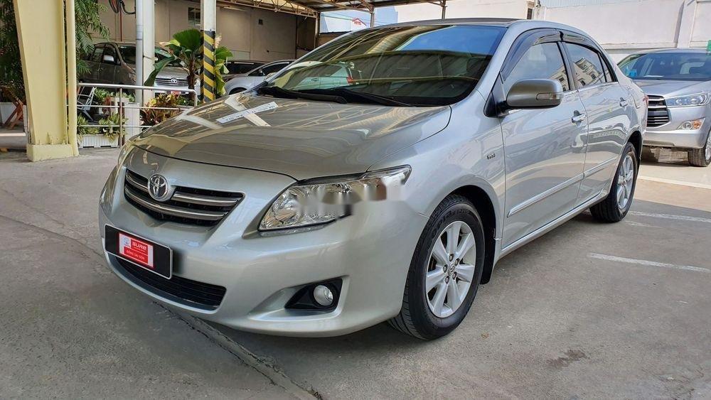 Cần bán gấp Toyota Corolla Altis 1.8AT sx 2009, màu bạc (1)