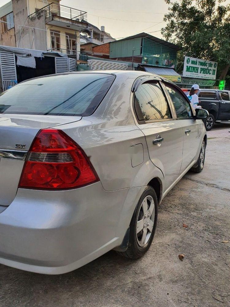 Cần bán lại xe Daewoo Gentra MT 2009, màu bạc xe gia đình (5)
